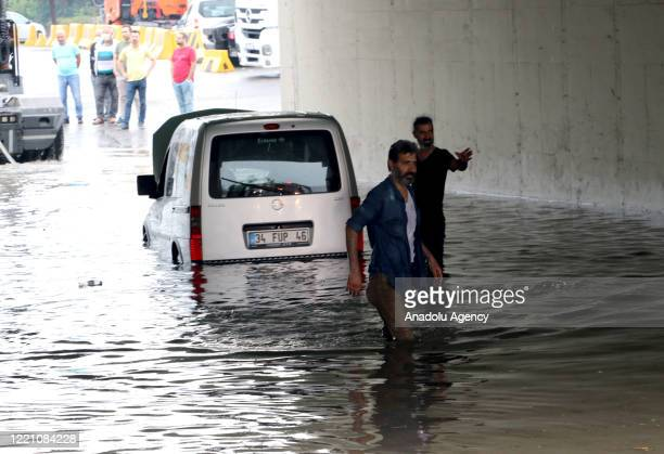 A car is seen trapped in a flooded underpass following a heavy rain in Istanbul Turkey on June 19 2020
