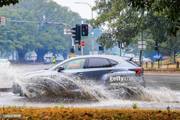 A car is seen traveling through flooded streets in Surry Hills as rain falls on January 17 2020 in Sydney Australia A severe thunderstorm warning has...