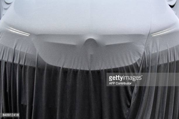 A car is seen under a protective cover as preparations are under way for the Internationale Automobil Ausstellung auto show on September 12 2017 in...