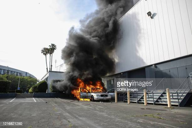 A car is set aflame by protesters during a protest against the killing of George Floyd Protesters took to the streets of Los Angeles for the fifth...