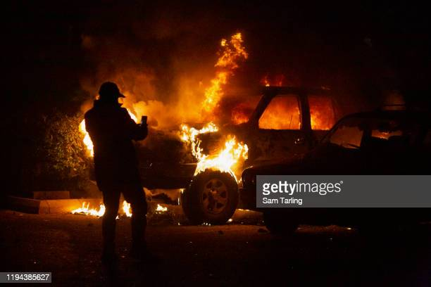 Car is set on fire by supporters of Shia political parties who clashed with security forces in the early hours of December 17, 2019 in Beirut,...