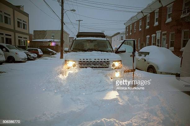A car is stuck in a snow drift during early morning hours as snow continues to fall on January 23 2016 in Philadelphia Pennsylvania The city is under...