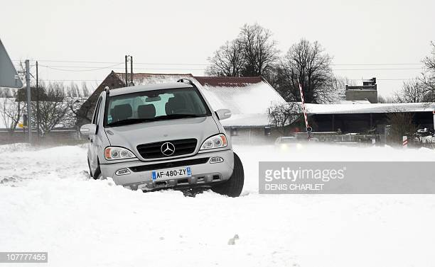 A car is stuck in the snow on December 24 2010 on a road near Blecourt northern France as the traffic is disrupted by freezing winter conditions AFP...