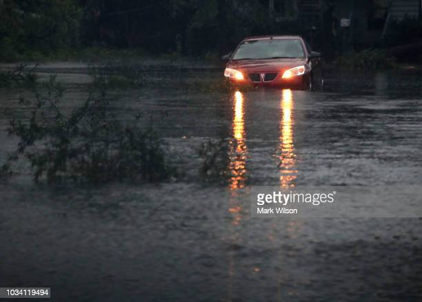 A car is stuck on a flooded street on September 16 2018 in Wilmington North Carolina Hurricane Florence hit Wilmington as a category 1 storm causing...