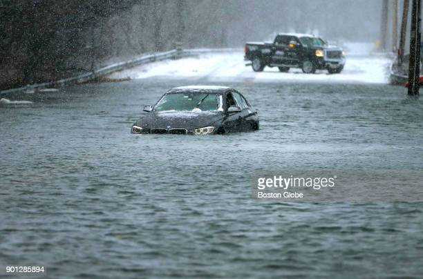 A car is surrounded by the ocean surge on Ocean Street in Green Harbor in Marshfield Mass on Jan 4 as the afternoon high tide struck during the...