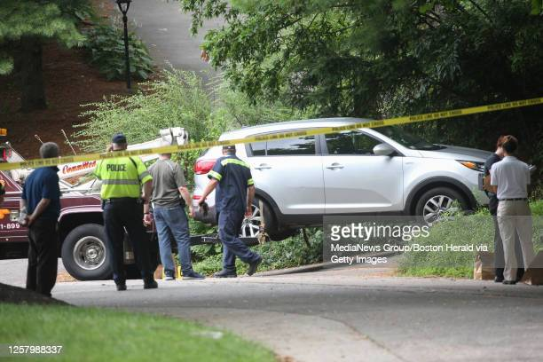 July 17, 2019: A car is towed away from the scene as police investigate the scene of a reported stabbing on Partridge Lane in Belmont, Massachusetts.