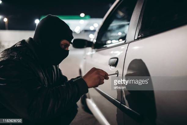 car jacking - thief stock pictures, royalty-free photos & images