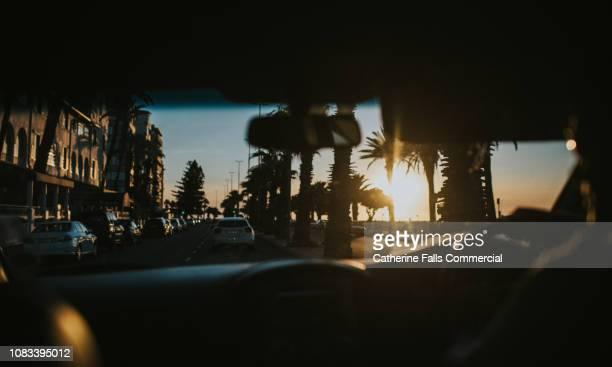 car journey at sunset - kapstadt stock-fotos und bilder