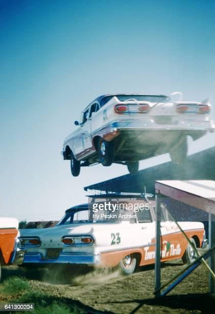 A car jumps over another car during the Sacramento State Fair circa August 1958 in Sacramento California