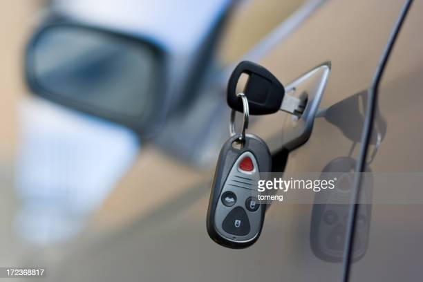 Car Key and Remote in Door of Silver Automobile