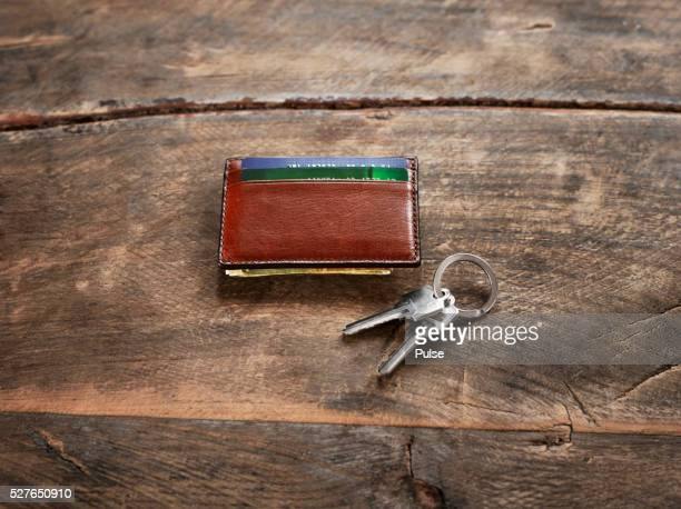 Car keys with wallet on night table
