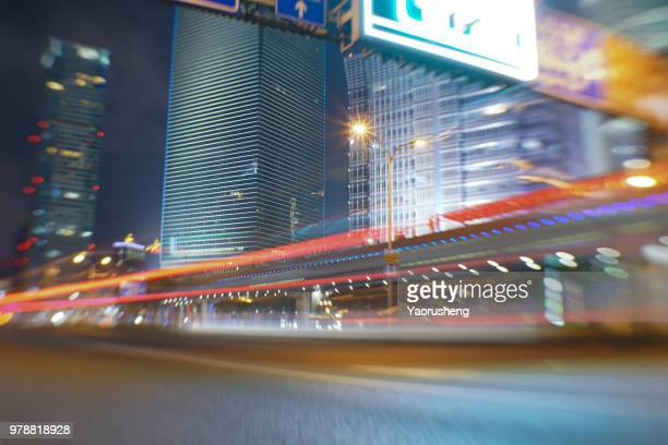 car lamps trails in modern city night,china