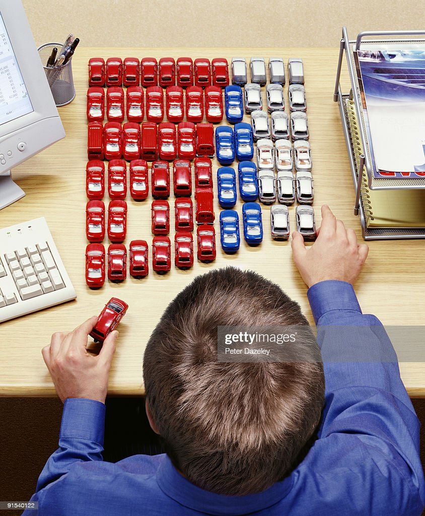 car lease car salesman at desk stock photo getty images