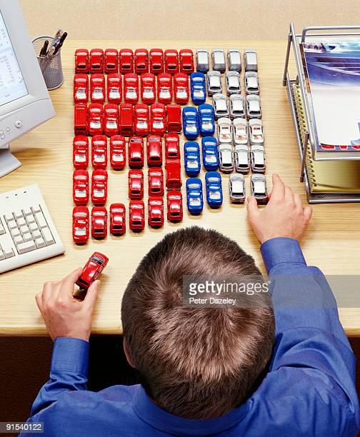 Car lease/ car salesman at desk.