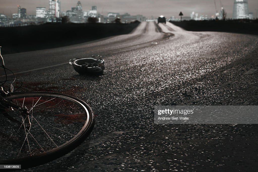 Car leaves the scene of a recent cycle accident : Stock-Foto