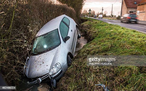 A car lies in a ditch following an accident in the northern French village of Meteren on January 29 2015 AFP PHOTO / PHILIPPE HUGUEN