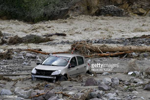 Car lies in mud after being moved by the floods of the Vesubie river in Roquebilliere, southeastern France, on October 3, 2020. After heavy rains and...