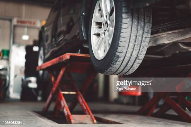car lifting - garage stock pictures, royalty-free photos & images