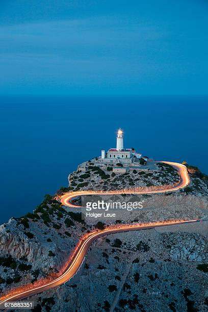 Car light streaks on road to Formentor lighthouse