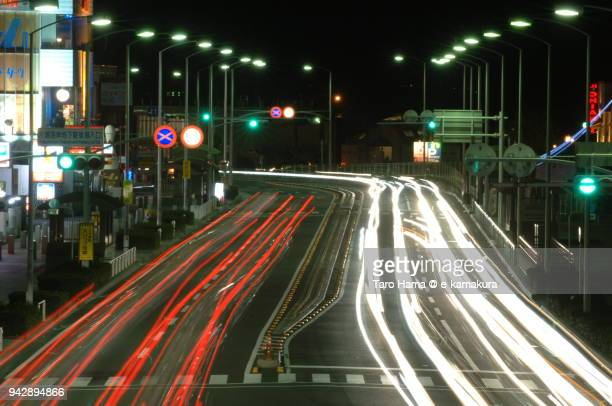 Car light track on the night road in Fujisawa city in Japan