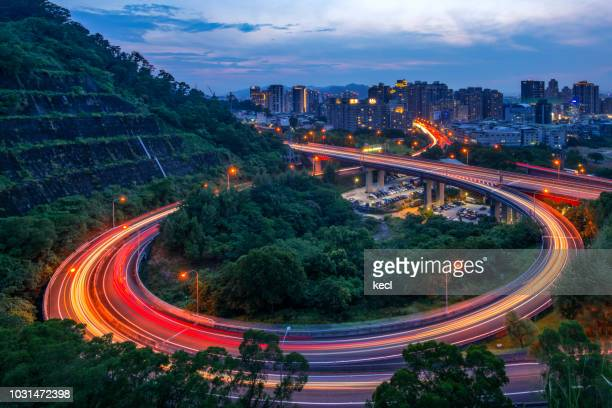 car light trails of highway interchange - taiwan stock pictures, royalty-free photos & images