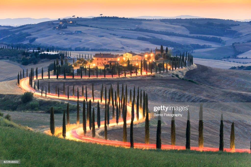 Car lighting in Zigzag road in Tuscany, Italy : Stock Photo