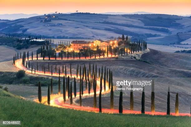 Car lighting in Zigzag road in Tuscany, Italy