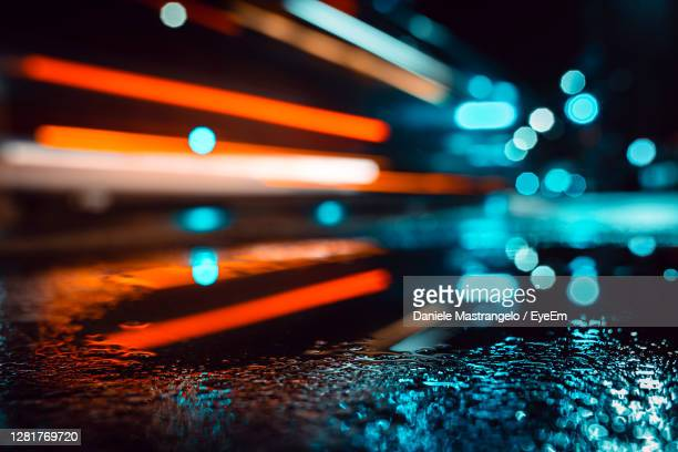 car lights after rain - lighting equipment stock pictures, royalty-free photos & images