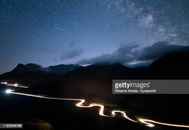 car lights at julier pass, engadine, switzerland - s shape stock photos and pictures