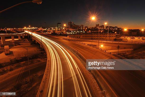 Car lights create streaks of light across the bridge over Ship Creek from downtown Anchorage Alaska to the port and Government Hill on Friday night...