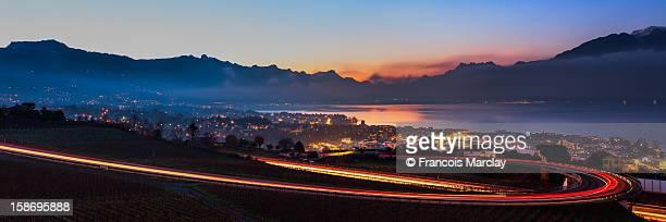 Car lights on the highway above Lake Geneva