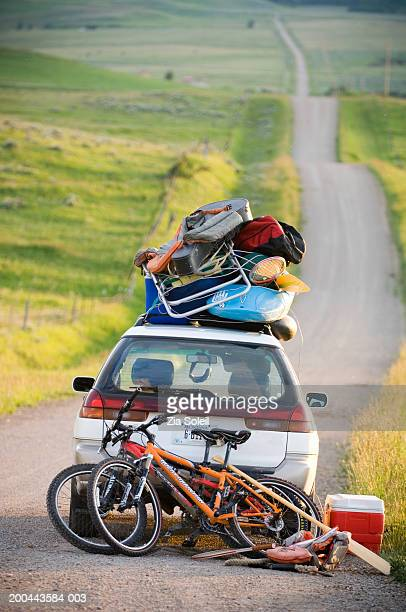 Car loaded with vacation gear on empty road