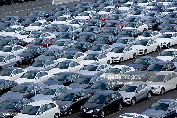 Car loading in the overseas port of Bremerhaven Mercedes cars on a loading dock on August 29 2014 in Bremerhaven Germany