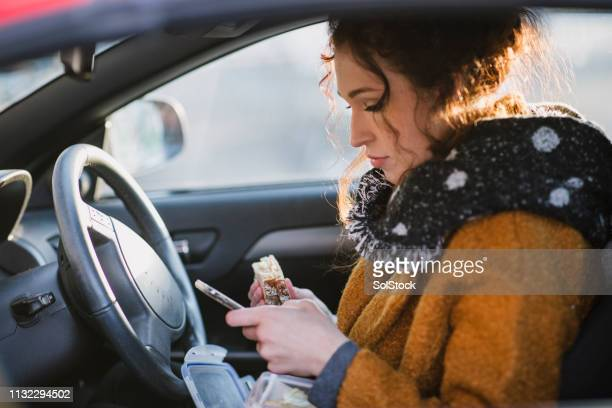car lunch - on the move stock pictures, royalty-free photos & images