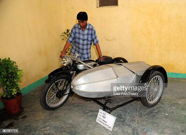Car Maintenance Supervisor Sunil Shukla looks an antique AJS 1928 motorcycle at 'Auto World' car museum in Kathwada some 20kms from Ahmedabad on...