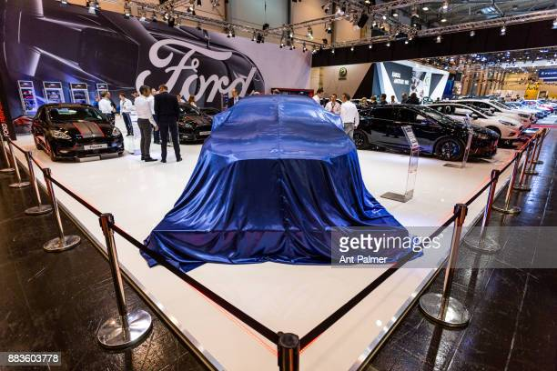 US car manufacturer Ford prepare to display the latest model of the Mustang at the Essen Motor Show on December 1 2017 in Essen Germany The Essen...