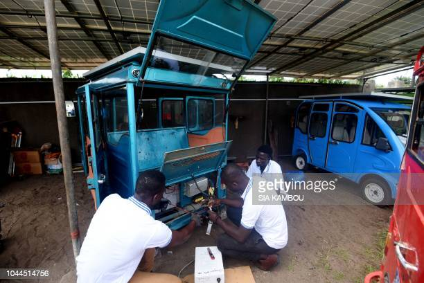 Car mecanics make a technical maintenance of a solarpowered vehicule on September 7 2018 in Jacqueville on the Ivorian coast Hitech cheap and quiet...