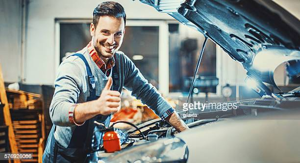 Car mechanic at work.