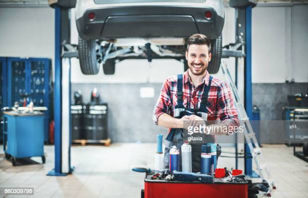 car mechanic at work. - auto repair shop stock pictures, royalty-free photos & images