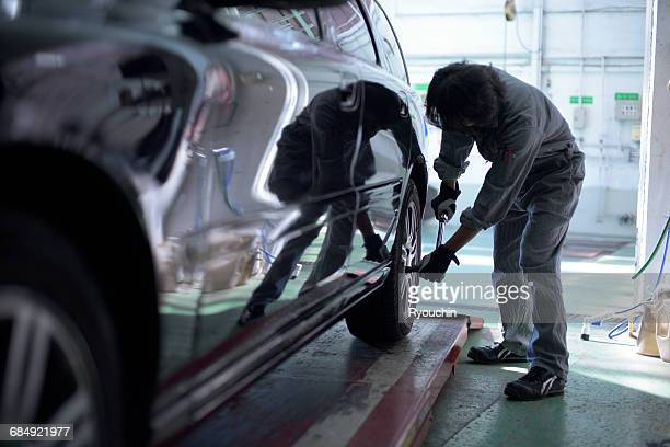 Car mechanic. Car repair, Maintenance plant