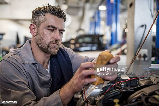 car mechanic in a workshop using diagnostic equipment - mechatronics stock pictures, royalty-free photos & images