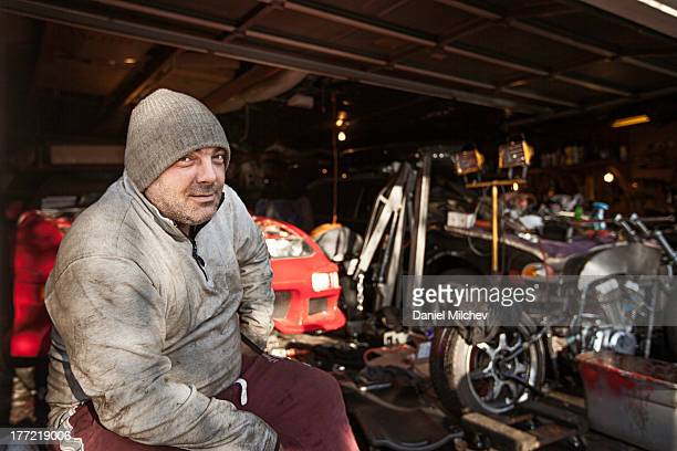 Car mechanic in his garage.