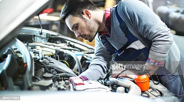 Car mechanic repair an engine.