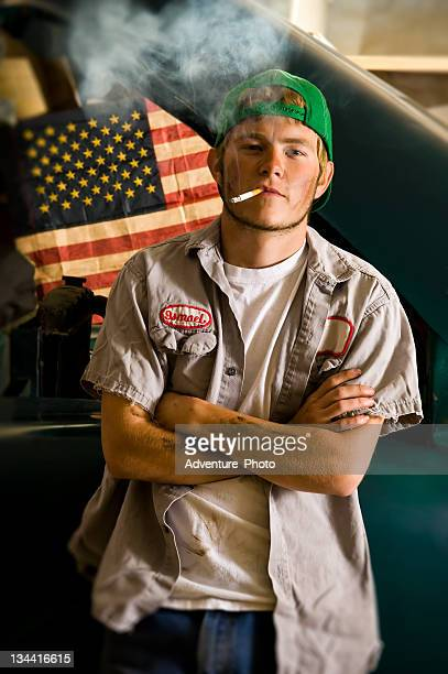 Car Mechanic Smoking Cigarette Environmental Portrait