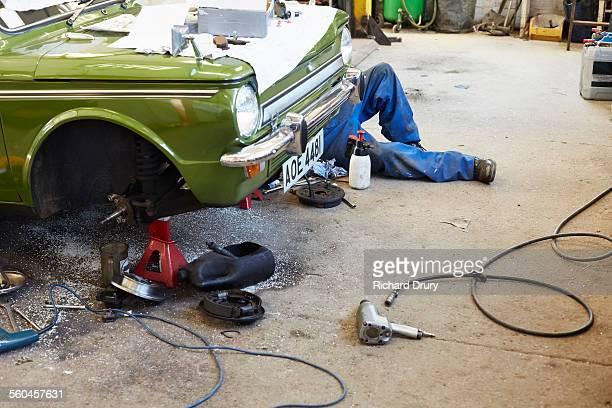 Car mechanic working on brake conversion