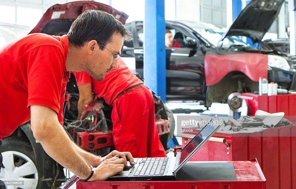 Car mechanics at work. : Stock Photo