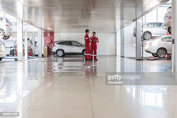 car mechanics in repair garage - auto repair shop stock pictures, royalty-free photos & images