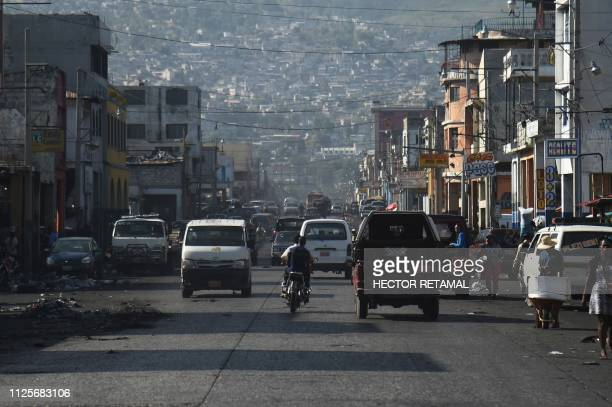 Car move along a street in the center of the Haitian capital PortauPrince on February 18 2019 The government presented a package of economic measures...