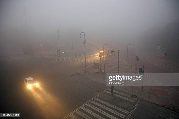 A car moves along an intersection shrouded in haze in New Delhi India on Monday Jan 20 2014 India China and Brazil three of the largest developing...