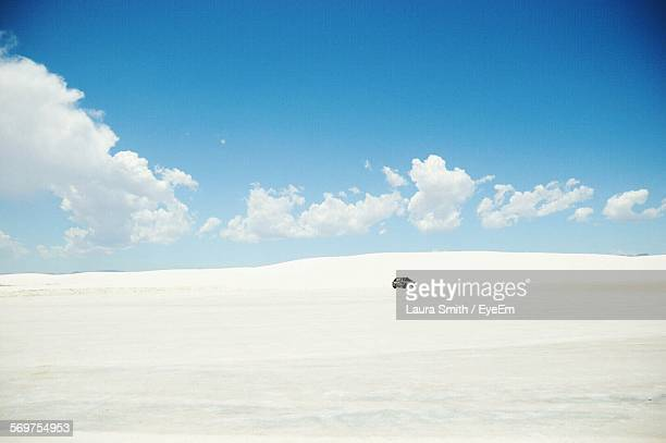 car moving against sky on snow covered landscape - las cruces new mexico stock pictures, royalty-free photos & images